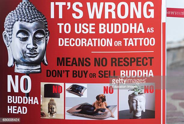 Poster asking tourist to respect Buddhism and refrain from using Buddha as decoration Bangkok Thailand