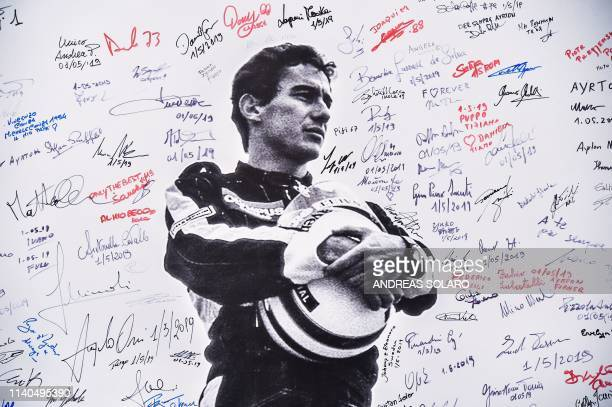 A poster bearing a photo of Brazilian's F1 driver Ayrton Senna signed by fans is displayed during a ceremony on May 1 2019 marking the 25th...