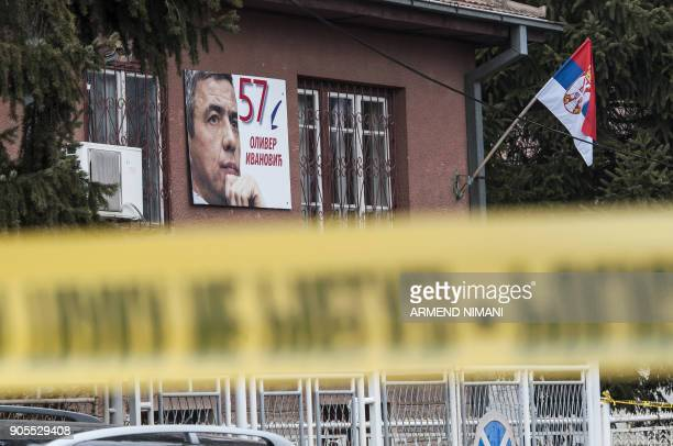 A poster bearing a picture of leading Kosovo Serb politician Oliver Ivanovic hangs on the wall of his offices after he was killed in a brazen driveby...