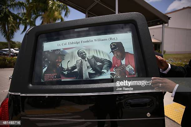 A poster board with photographs of retired Air Force Lt Col Eldridge Williams is placed in the window of the hearse during his funeral at the Sweet...