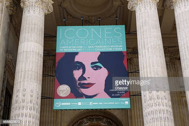 A poster by US artist Andy Warhol entitled 'Liz' is displayed at the entrance to the Grand Palais during the press opening of the exhibition 'Icones...