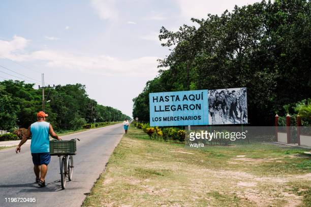 poster commemorating the battle in the bay of pigs, where the mercenary army, backed by the u.s., was defeated by the cuban revolutionary army. the caption reads: so far the mercenaries came. - news event stock pictures, royalty-free photos & images