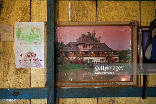 A poster depicting a dream house and a child's drawing of the family tree decorate the walls of a oneroom house on November 17 2009 in the town of...