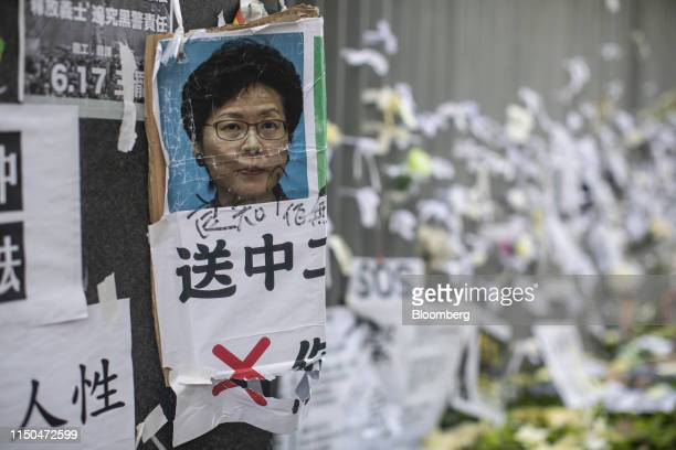 A poster depicting Hong Kong Chief Executive Carrie Lam is displayed on a wall outside the Central Government Offices in Hong Kong China on Tuesday...