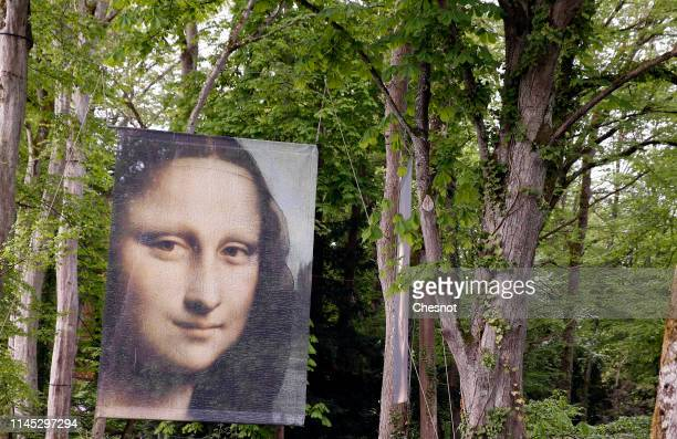 A poster depicting the Mona Lisa by Leonardo da Vinci is displayed in the garden of Clos Luce castle on April 26 2019 in Amboise France The castle of...
