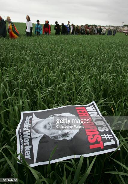 A poster depicting US President Bush is seen in a field near the security fence surrouding the G8 summit on July 6 2005 near Gleneagles The G8 summit...