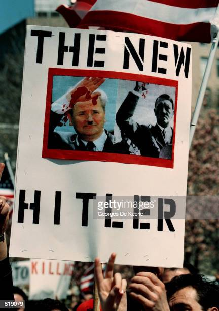 Poster depicting Yugoslavia's Slobodan Milošević as Adolf Hitler is held by Albanian-American protesters who gathered in Lafayette Park across from...