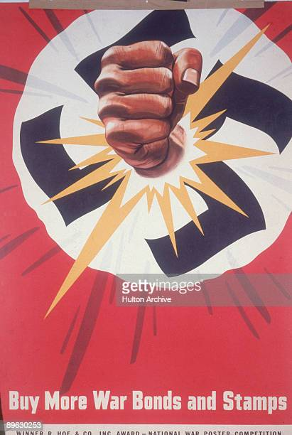 Poster depicts a fist as it smashes through a swastika above the phrase 'Buy More War Bonds and Stamps' early to mid 1940s The poster was apparently...