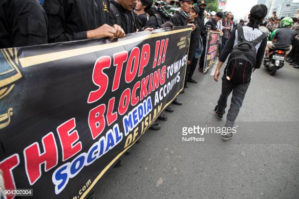 A poster during the demonstration displayed Hundreds of muslims from Indonesian Islam defender and some underbow muslim organization held...