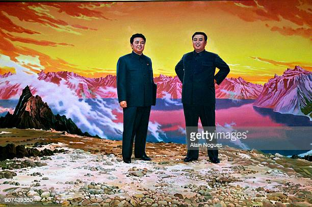 Poster exhibited near the Party monument building depicting North Korean leaders Kim Jong Il and President Kim Il Sung at the summit of Mount Paektu