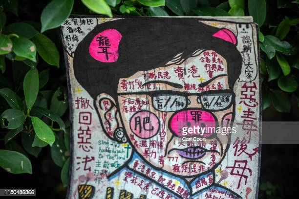 A poster featuring a depiction of Hong Kong Chief executive Carrie Lam lies against the fence of the Legislative Council building on June 18 2019 in...