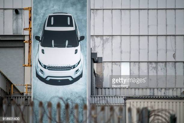 A poster featuring a Range Rover Evoque sits outside Jaguar Land Rover's assembly plant in Halewood UK on Monday Feb 5 2018 Being split off from...