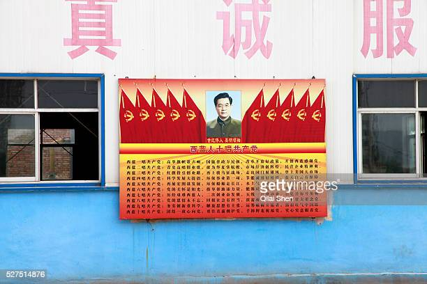 Poster featuring Chinese President Hu Jintao hang on the wall of a China Natural Gas filler station in Xi'an, Shaanxi Province, China on 11 August...