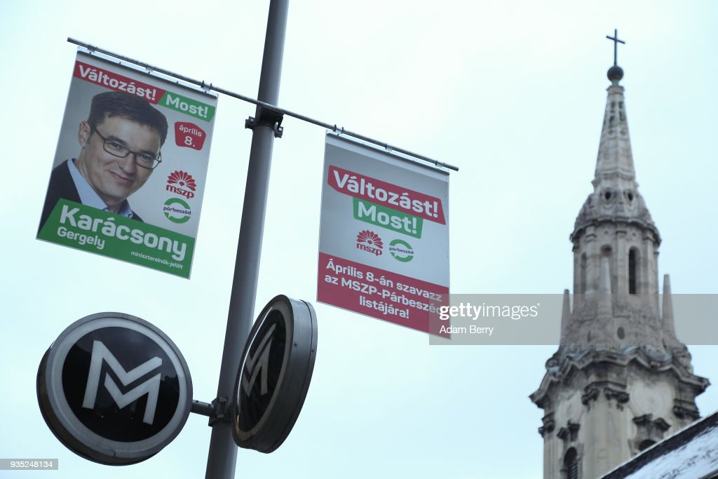 A poster featuring Dialogue for Hungary (Parbeszed Magyarorszagert) party candidate Gergely Karacsony hangs prior to the upcoming Hungarian parliamentary elections on April 8, on March 18, 2018 in Budapest, Hungary. Incumbent Prime Minister Viktor Orban faces only a few disorganized opposition parties standing in the way of a possible third term, although the popularity of his own, Fidesz, once a liberal student movement and now advocating an increasingly anti-immigrant, anti-European Union platform after dominating Hungarian politics on both national and local levels since 2010, has fallen since December. It suffered a surprising setback last month in its southern town stronghold of Hodmezovasarhely, when an opposition-backed independent won an easy victory, giving hope to other contenders for success in the national elections in early April.