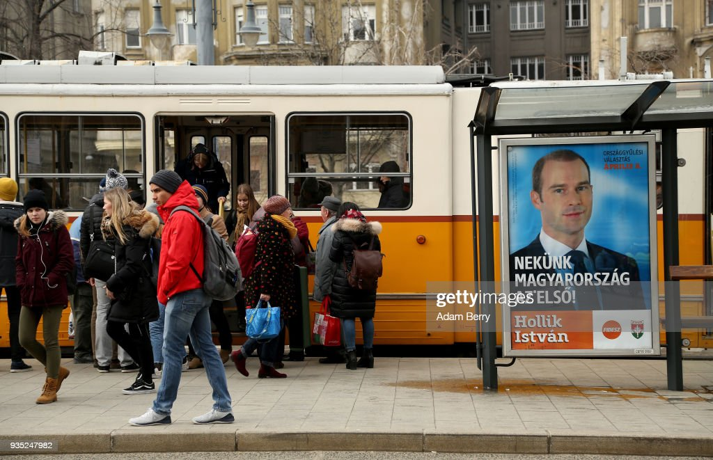 A poster featuring Fidesz party candidate Hollik Istvan hangs prior to the upcoming Hungarian parliamentary elections on April 8, on March 20, 2018 in Budapest, Hungary. Incumbent Prime Minister Viktor Orban faces only a few disorganized opposition parties standing in the way of a possible third term, although the popularity of his own, Fidesz, once a liberal student movement and now advocating an increasingly anti-immigrant, anti-European Union platform after dominating Hungarian politics on both national and local levels since 2010, has fallen since December. It suffered a surprising setback last month in its southern town stronghold of Hodmezovasarhely, when an opposition-backed independent won an easy victory, giving hope to other contenders for success in the national elections in early April.