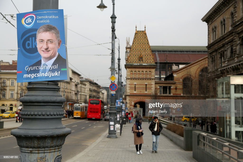 A poster featuring former Hungarian prime minister and Democratic Coalition (Hungarian: Demokratikus Koalicio, or DK) party candidate Ferenc Gyurcsany hangs prior to the upcoming Hungarian parliamentary elections on April 8, on March 20, 2018 in Budapest, Hungary. Incumbent Prime Minister Viktor Orban faces only a few disorganized opposition parties standing in the way of a possible third term, although the popularity of his own, Fidesz, once a liberal student movement and now advocating an increasingly anti-immigrant, anti-European Union platform after dominating Hungarian politics on both national and local levels since 2010, has fallen since December. It suffered a surprising setback last month in its southern town stronghold of Hodmezovasarhely, when an opposition-backed independent won an easy victory, giving hope to other contenders for success in the national elections in early April.