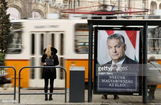 A poster featuring Hungarian Prime Minister Viktor Orban hangs prior to the upcoming Hungarian parliamentary elections on April 8 on March 17 2018 in...
