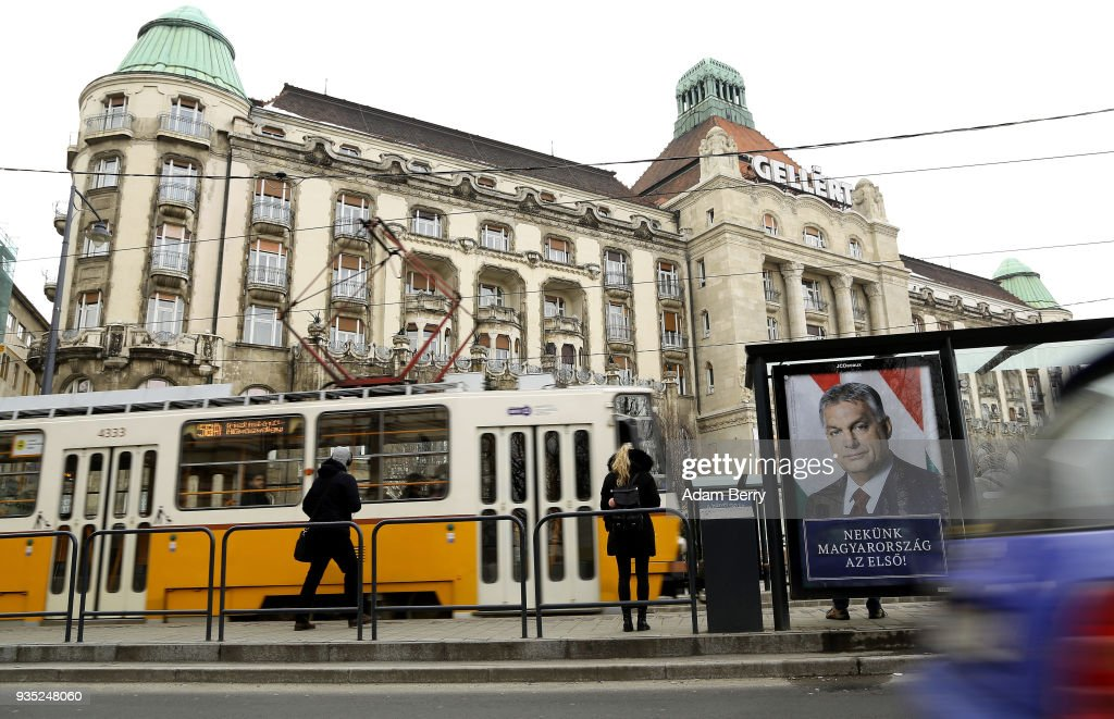 A poster featuring Hungarian Prime Minister Viktor Orban hangs prior to the upcoming Hungarian parliamentary elections on April 8, on March 20, 2018 in Budapest, Hungary. Orban faces only a few disorganized opposition parties standing in the way of a possible third term, although the popularity of his own, Fidesz, once a liberal student movement and now advocating an increasingly anti-immigrant, anti-European Union platform after dominating Hungarian politics on both national and local levels since 2010, has fallen since December. It suffered a surprising setback last month in its southern town stronghold of Hodmezovasarhely, when an opposition-backed independent won an easy victory, giving hope to other contenders for success in the national elections in early April.