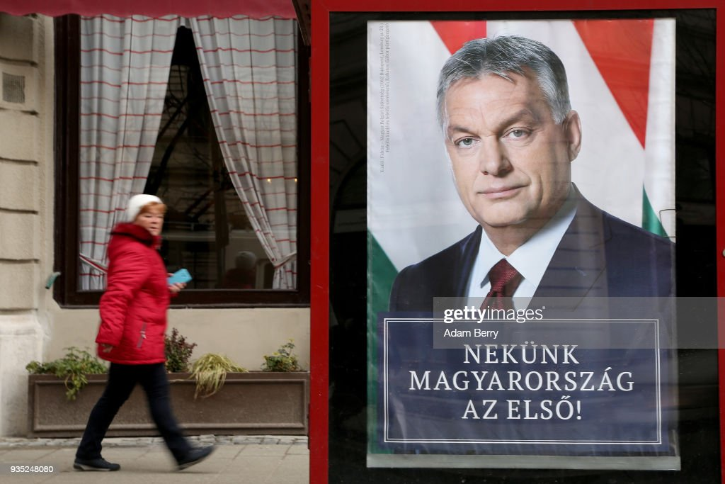 A poster featuring Hungarian Prime Minister Viktor Orban hangs prior to the upcoming Hungarian parliamentary elections on April 8, on March 17, 2018 in Budapest, Hungary. Orban faces only a few disorganized opposition parties standing in the way of a possible third term, although the popularity of his own, Fidesz, once a liberal student movement and now advocating an increasingly anti-immigrant, anti-European Union platform after dominating Hungarian politics on both national and local levels since 2010, has fallen since December. It suffered a surprising setback last month in its southern town stronghold of Hodmezovasarhely, when an opposition-backed independent won an easy victory, giving hope to other contenders for success in the national elections in early April.