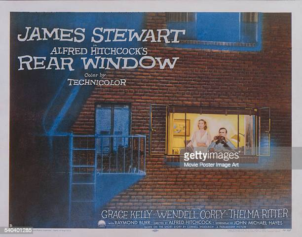 A poster for Alfred Hitchcock's 1954 mystery film 'Rear Window' starring James Stewart and Grace Kelly