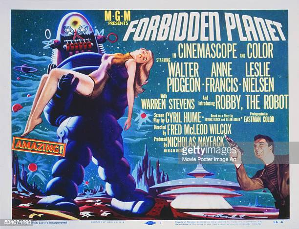 A poster for Fred M Wilcox's 1956 science fiction film 'Forbidden Planet' featuring Robby the Robot Anne Francis and Leslie Nielsen
