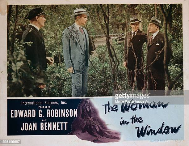 A poster for Fritz Lang's 1944 crime film 'The Woman in the Window' starring Raymond Massey and Edward G Robinson