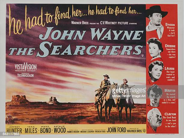 A poster for John Ford's 1956 adventure film 'The Searchers' starring John Wayne Jeffrey Hunter Vera Miles Natalie Wood and Ward Bond