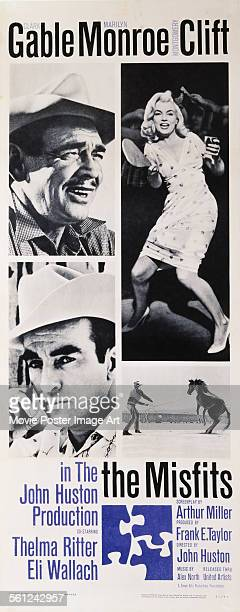 A poster for John Huston's 1961 drama 'The Misfits' starring Clark Gable Marilyn Monroe and Montgomery Clift
