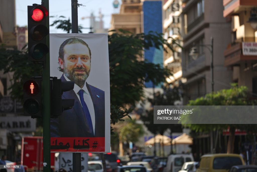 A poster for Lebanese Prime Minister Saad Hariri is seen hanging on a traffic signal in Beirut's Hamra street on November 15, 2017. Lebanon's President Michel Aoun accused Saudi Arabia of having 'detained' Hariri, who announced his resignation in a statement from the kingdom earlier this month. / AFP PHOTO / Patrick BAZ