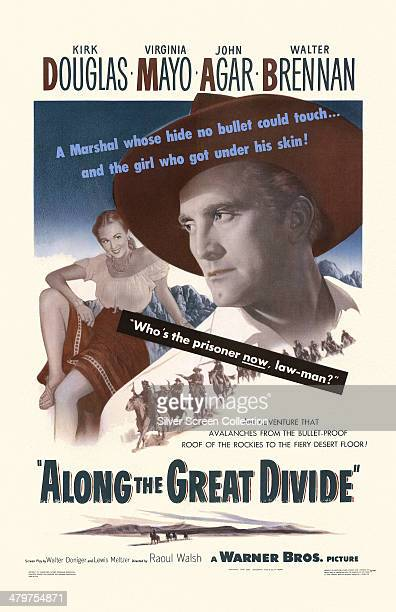 A poster for Raoul Walsh's 1951 western 'Along The Great Divide' starring Kirk Douglas and Virginia Mayo