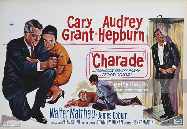 A poster for Stanley Donen's 1963 'Charade' starring Cary Grant and Audrey Hepburn