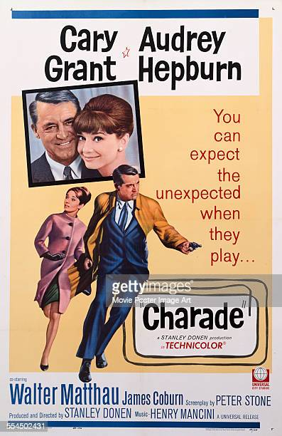 A poster for Stanley Donen's 1963 comedy 'Charade' starring Cary Grant and Audrey Hepburn