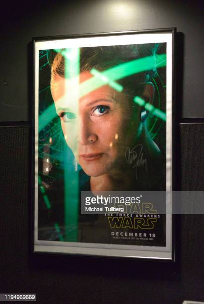 """Poster for """"Star Wars: The Force Awakens"""" signed by actress Carrie Fisher at the Carrie Fisher pop-up museum """"The Todd Fisher Collection"""" at TCL..."""