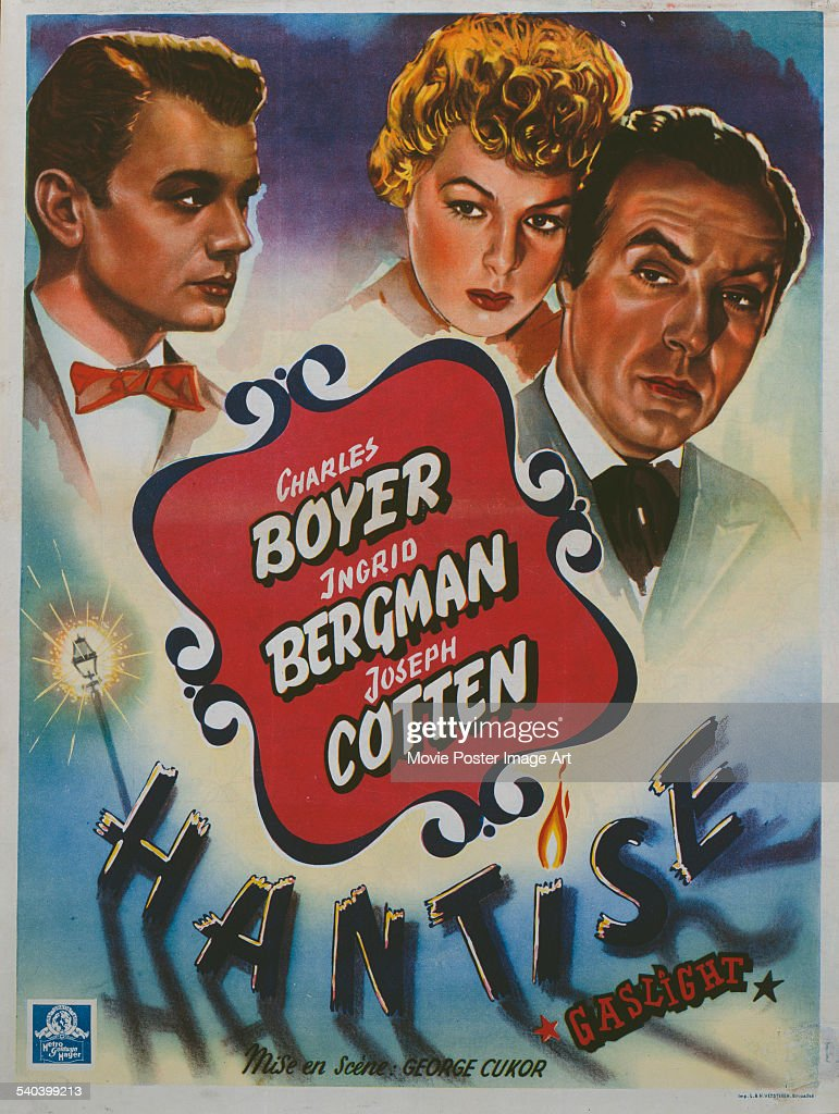 A poster for the Belgian release of George Cukor's 1944 mystery-thriller, 'Gaslight' ('Hantise'), starring (left to right) Joseph Cotten, Ingrid Bergman and Charles Boyer.
