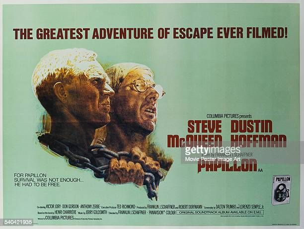 A poster for the British release of Franklin J Schaffner's 1973 prison drama 'Papillon' starring Steve McQueen and Dustin Hoffman