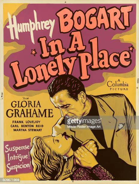 A poster for the Columbia Pictures movie 'In a Lonely Place' featuring actors Humphrey Bogart and Gloria Grahame 1950