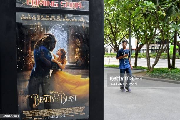 A poster for the film 'Beauty and the Beast' is displayed in Singapore on March 14 2017 The film has come under fire from religious figures in...