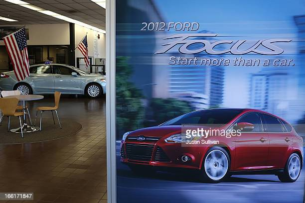 A poster for the Ford Focus is displayed on the sales floor at Serramonte Ford on April 9 2013 in Colma California According to a report by RL Polk...