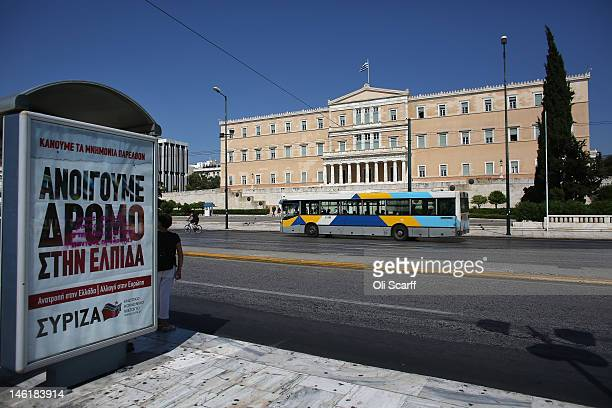 A poster for the leftwing Syriza party on a bus stop in Syntagma Square in front of the Parliament building on June 11 2012 in Athens Greece The...