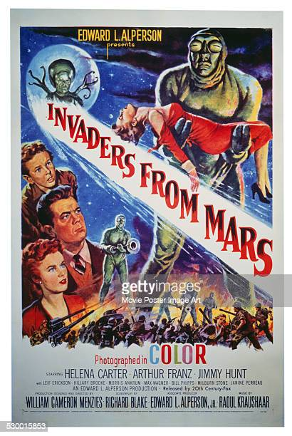 A poster for William Cameron Menzies' 1953 horror film 'Invaders from Mars' starring Helena Carter Arthur Franz and Jimmy Hunt