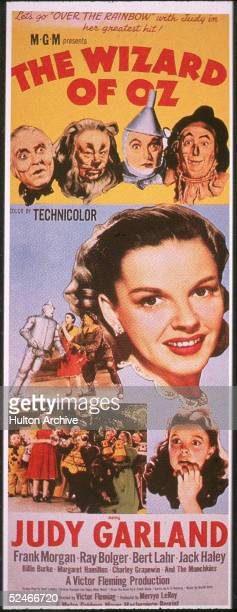 A poster from the film 'The Wizard Of Oz' shows an illustration of American actress Judy Garland and at top left to right actors Frank Morgan Bert...