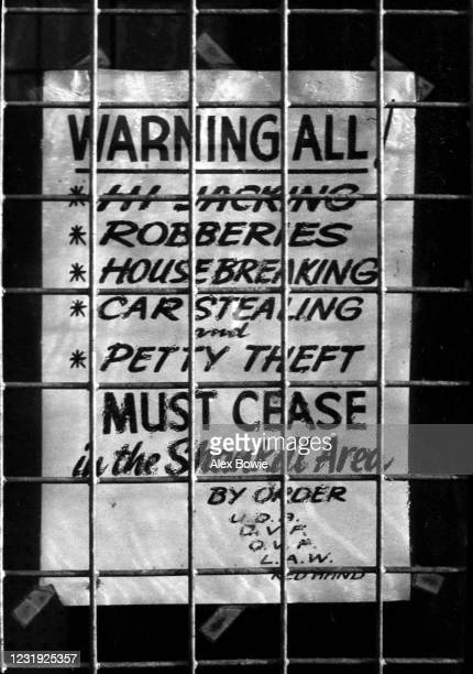 Poster in a barred shop window in the loyalist Shankill Road district of west Belfast reads: Warning All – Hi-Jacking, Robberies, Housebreaking, Car...