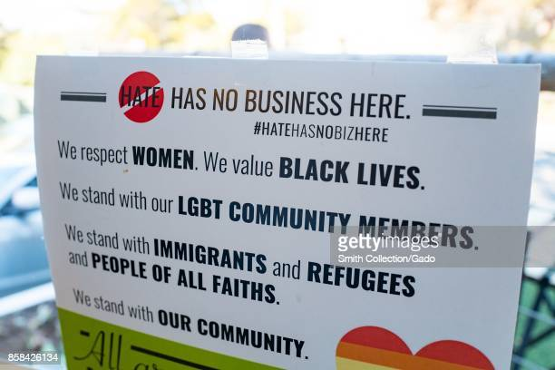 Poster in a shop window in Berkeley California reading Hate has no business here and listing several causes including Black Lives Matter and LGBT...