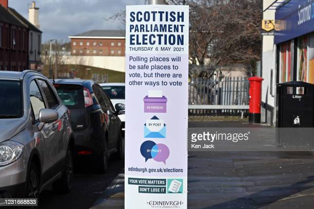 Poster in Edinburgh publicising the Scottish Parliament Election to be held on May 6, and alternatives to in-person voting, including postal voting,...