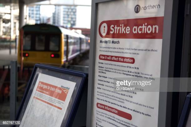 A poster in Manchester Victoria train station gives details of the reduced transport service due to industrial action taken by the RMT union in...