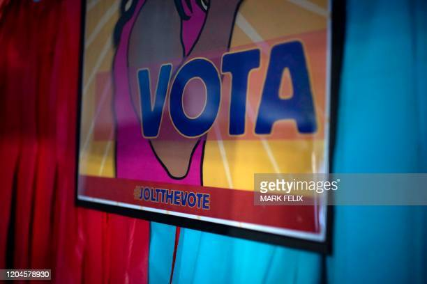 A poster is displayed on a wall at the headquarters of Jolt a nonprofit organization that works to increase the civic participation of Latinos in...