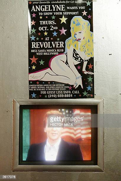 A poster is placed near a tv screen displaying a talk show program at the entrance of the club Revolver as it announces an event with Gubernatorial...
