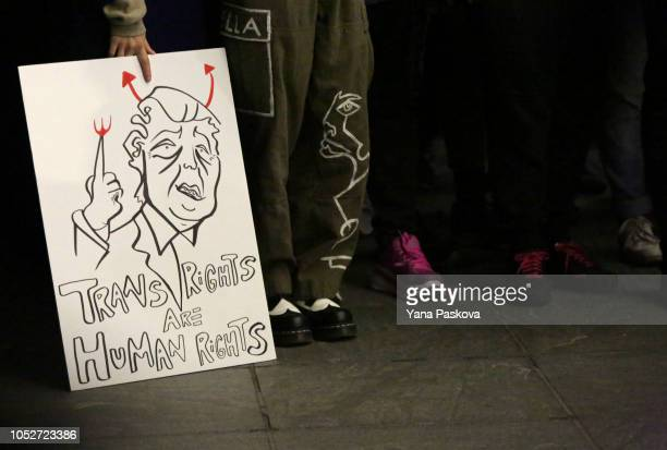 A poster is seen at a rally for LGBTQI rights at Washington Square Park on October 21 2018 in New York City Based on a leaked memo The New York Times...