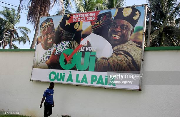 A poster is seen on the board at the street in Abidjan prior to the referendum which will be held at October 30 after new Constitutional Draft...