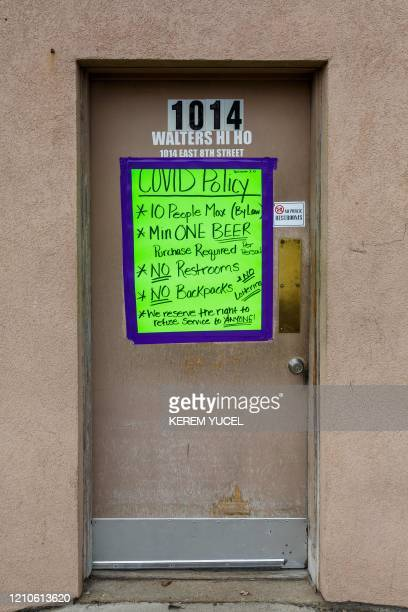 A poster lists rules at a bar open amid the coronavirus COVID19 pandemic on April 20 in Sioux Falls South Dakota For months sparsely populated South...